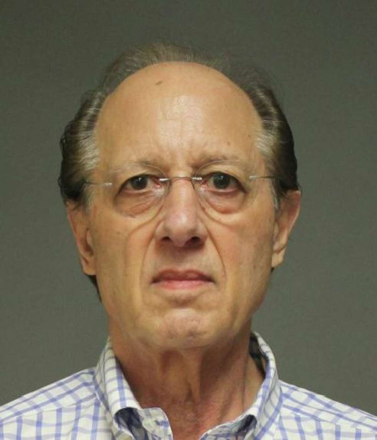Former Fairfield Chief Fiscal Officer Robert Mayer was charged with third-degree burglary, third-degree larceny and tampering with evidence.