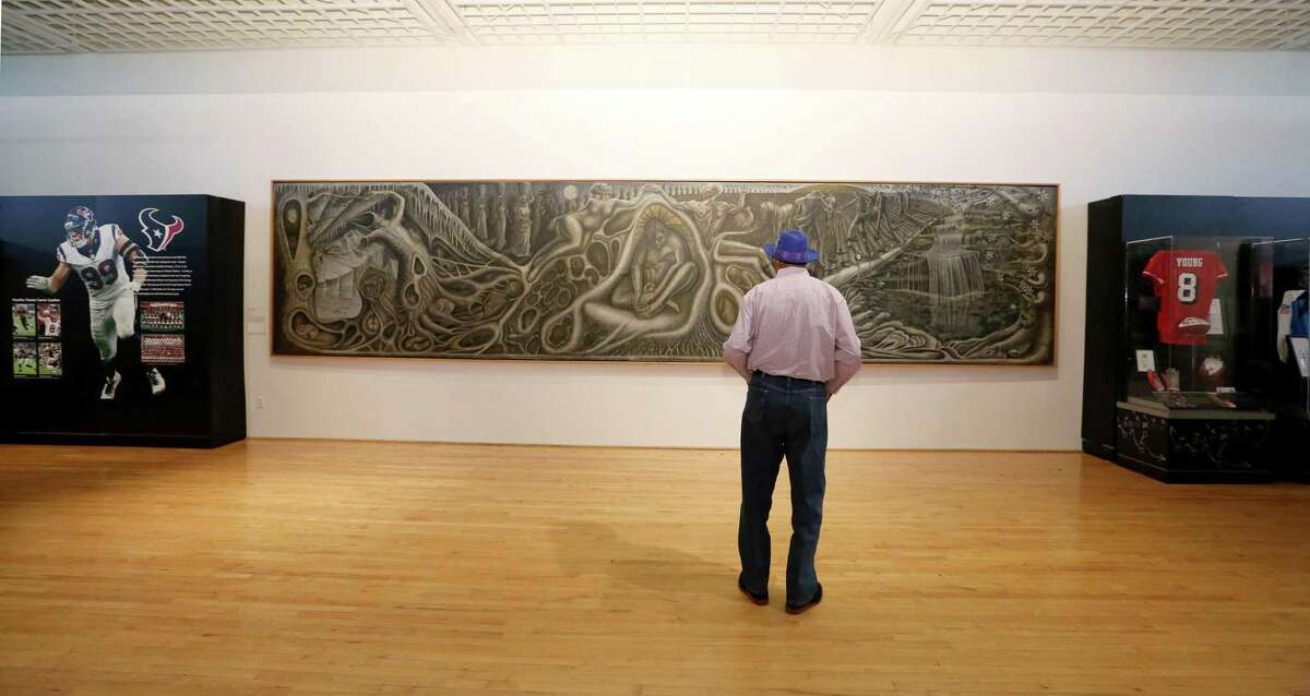 """Ronald """"Buck"""" Goodbeer, 70, of Houston, takes a moment to look at John T. Biggers' """"Web of Life"""" mural at Texas Southern University's University Museum Thursday, Feb. 2, 2017, in Houston."""