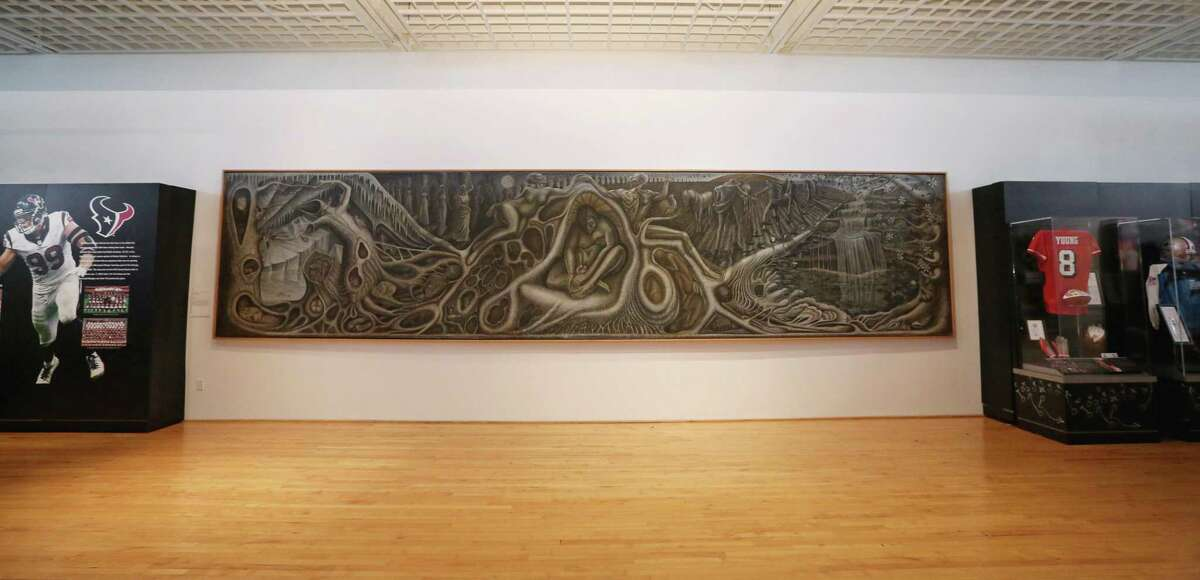 """John T. Biggers' """"Web of Life"""" mural is placed between the Hometown Heroes, left, and Dynasties sections of the Gridiron Glory: The Best of the Pro Football Hall of Fame exhibition at Texas Southern University's University Museum Thursday, Feb. 2, 2017, in Houston."""