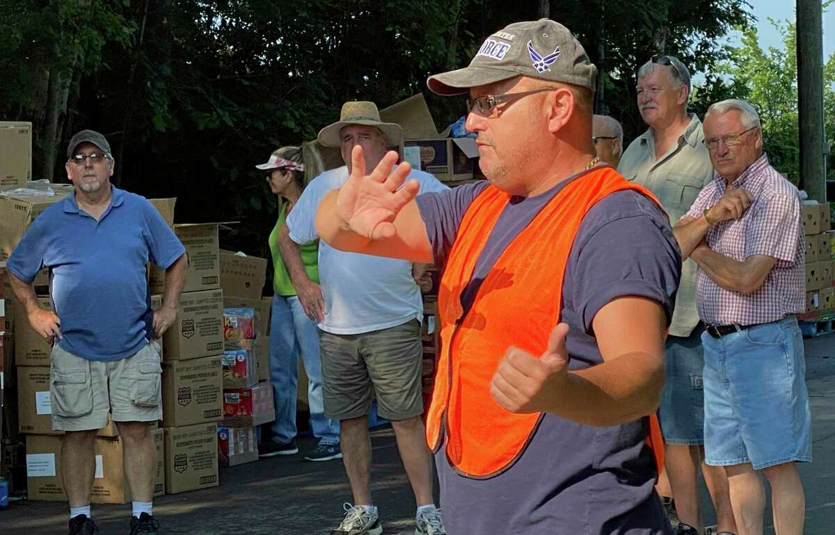 Pop-up food pantry organizer Kurt Damrow speaks with volunteers prior to Wednesday's food distribution at the Ubly Fox Hunters Club. About 22,000 pounds of found was distributed to 265 families on Wednesday. (Mark Birdsall/Huron Daily Tribune)