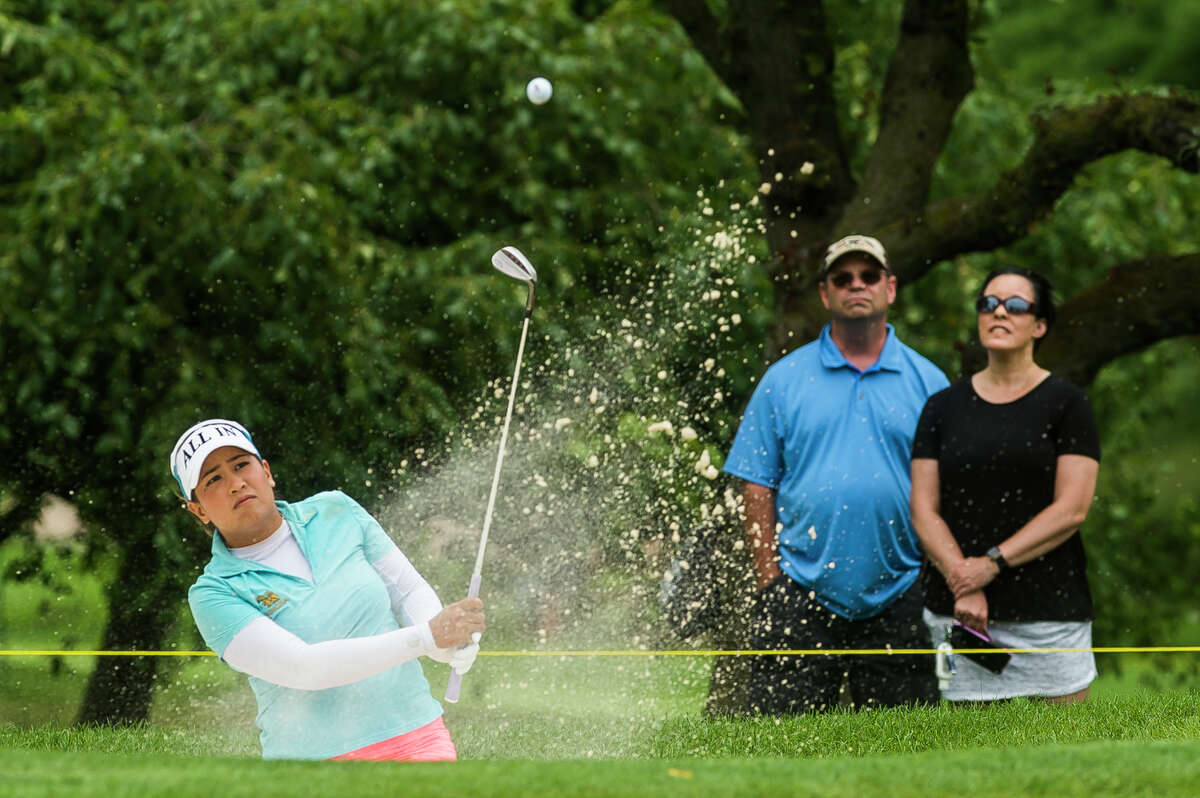 LPGA player Jasmine Suwannapura chips out of a bunker while competing in the third round of play during the Dow Great Lakes Bay Invitational Friday, July 16, 2021 at the Midland Country Club. (Katy Kildee/kkildee@mdn.net)