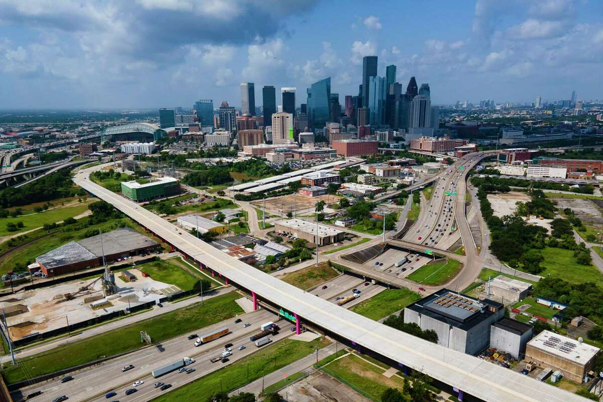 Cars pass over the new Elysian Viaduct following a ribbon-cutting ceremony celebrating the opening of the new bridge from Near Northside to downtown Houston on Friday, July 16, 2021. The $35.6 million bridge crossing Interstate 10 and the Buffalo Bayou replaced the previous bridge with a wider roadway.
