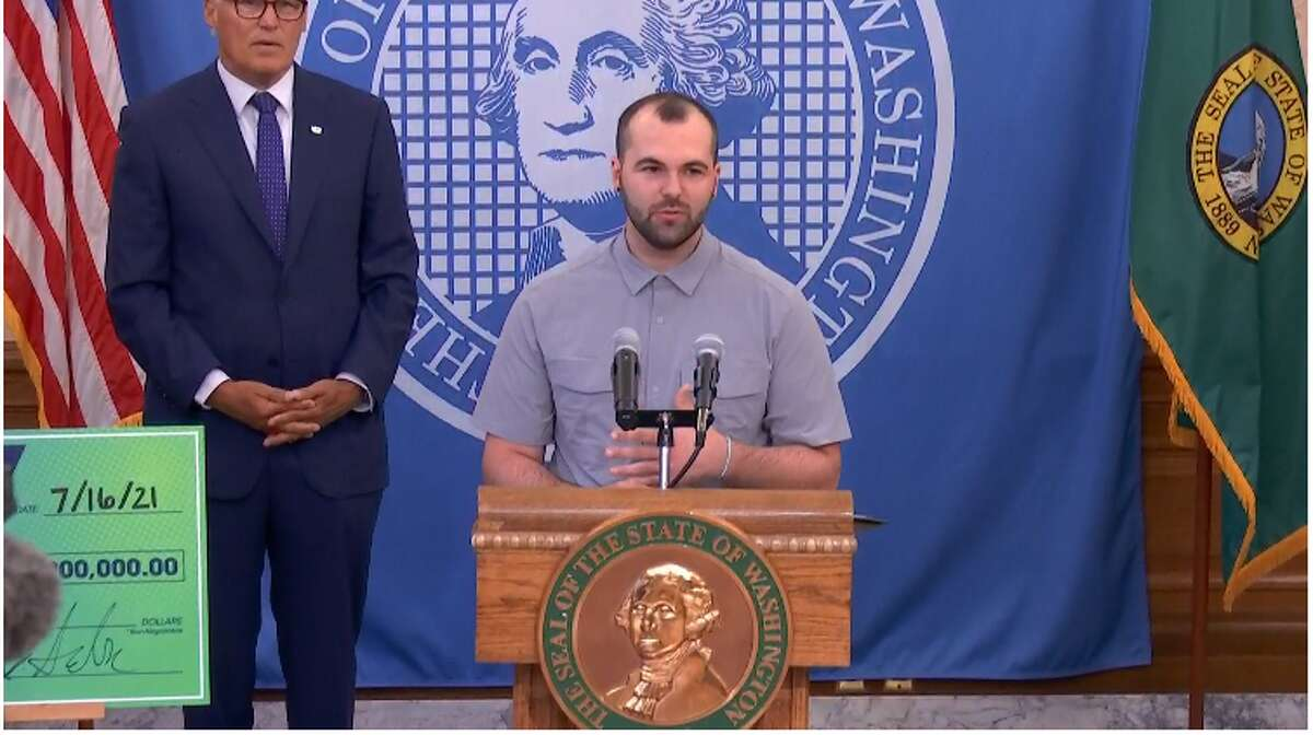 Kameron P., a 23-year-old motorcycle mechanic, won $1 million in Washington's vaccine lottery. He speaks at a press conference at the State Capitol Friday, July 16, 2021.