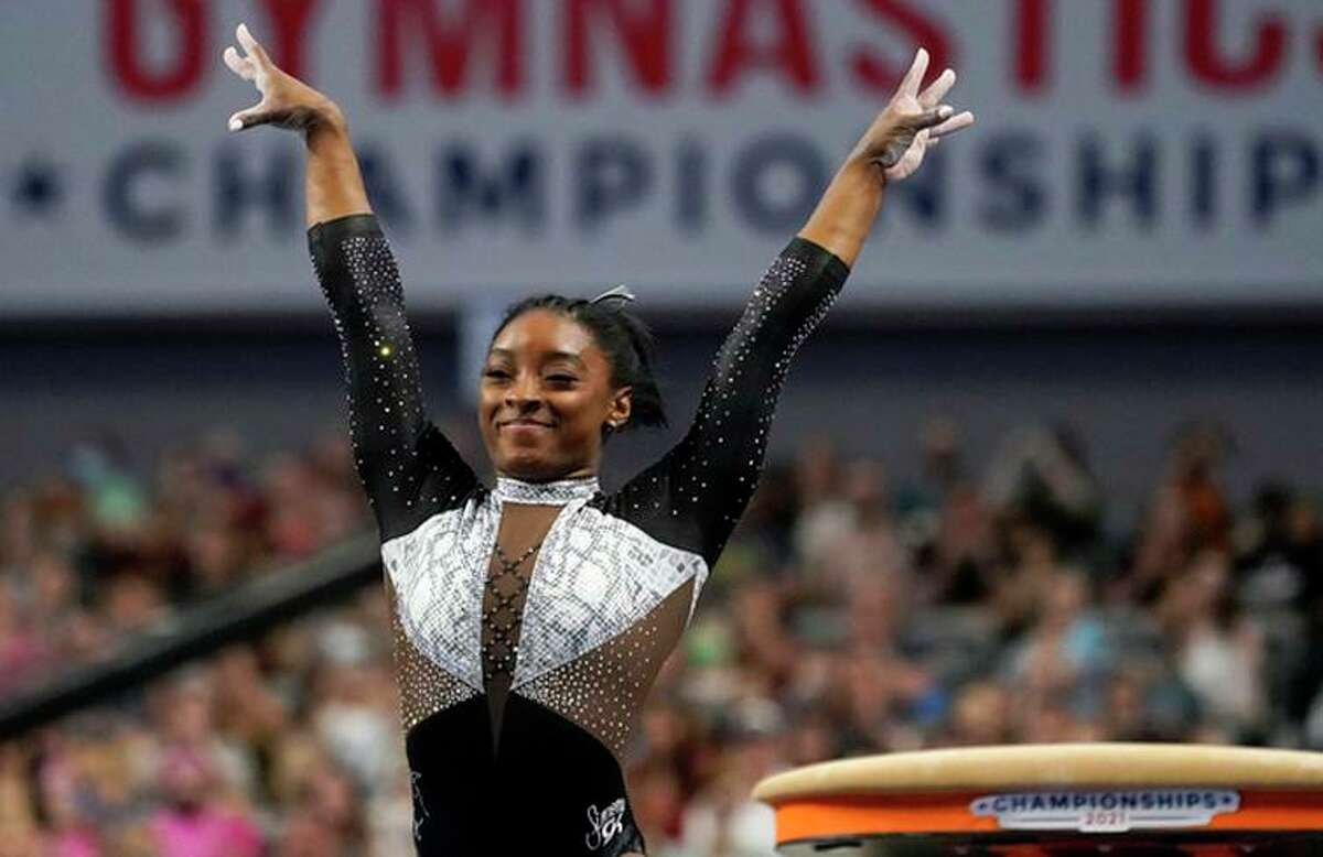 Simone Biles celebrates after competing in the vault during the U.S. Gymnastics Championships in Fort Worth.