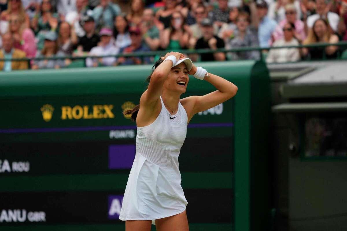 Britain's Emma Raducanu celebrates winning the women's singles third round match against Romania's Sorana Cirstea on day six of the Wimbledon Tennis Championships in London, Saturday July 3, 2021. (AP Photo/Alberto Pezzali)