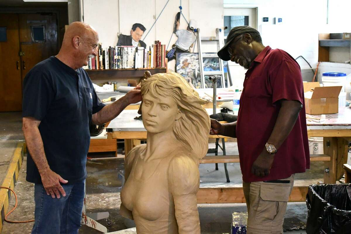 Ralph Chilton (left) and Eddie Dixon work on the Yellow Rose of Texas, their latest sculpture project that is slated to be put up on the River Walk in San Antonio.