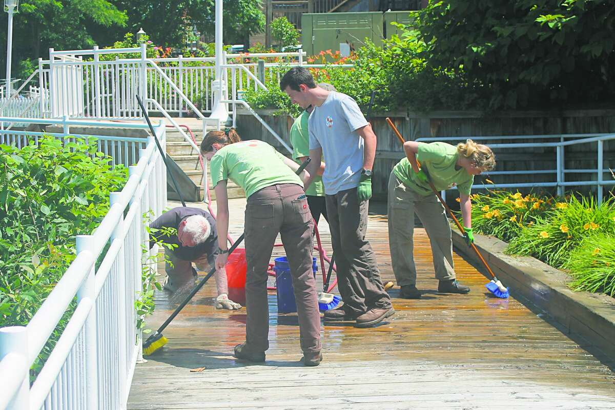Members of Manistee SEEDS clean the Riverwalk on July 9 to help Manistee Proud accomplish its goal of restoring it to its former glory. This week, Kelly Greve, who heads up the group, along with other residents spoke during a Manistee City Council work session about the current state of the city's infrastructure.