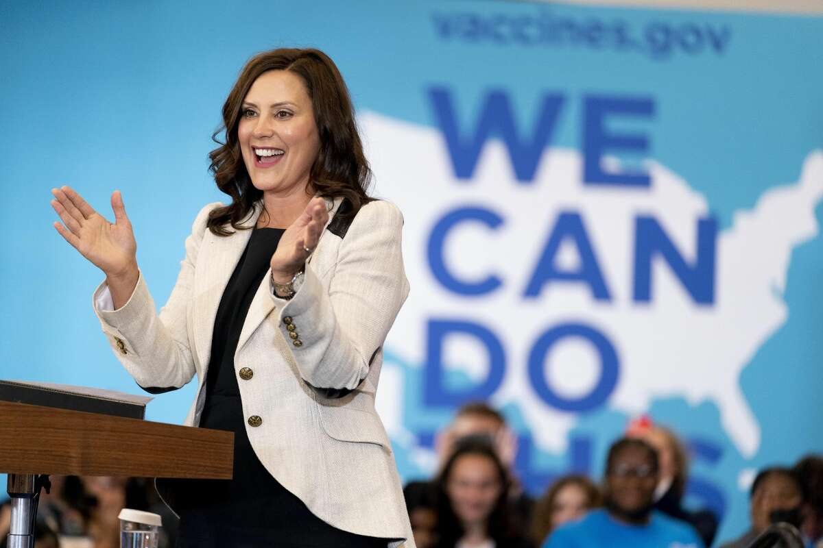 In a photo from July 12, 2021, Michigan Gov. Gretchen Whitmer speaks at a vaccine mobilization event before Vice President Kamala Harris takes the stage at the TCF Center in Detroit. Gov. Whitmer signed off on a $17.1 billion K-12 budget Tuesday in Grand Rapids, a 10% increase in overall funding that aims to close a decades-long funding gap among school districts in Michigan.