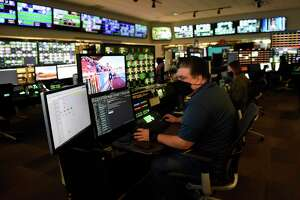 BOC manager Philip Maggio works in the broadcast operations center at NBC Sports headquarters in Stamford, Conn. Tuesday, July 13, 2021. NBC Sports is preparing to cover the Tokyo 2020 Olympic Games, which were postponed a year, in a different way than usual due to the lingering pandemic.