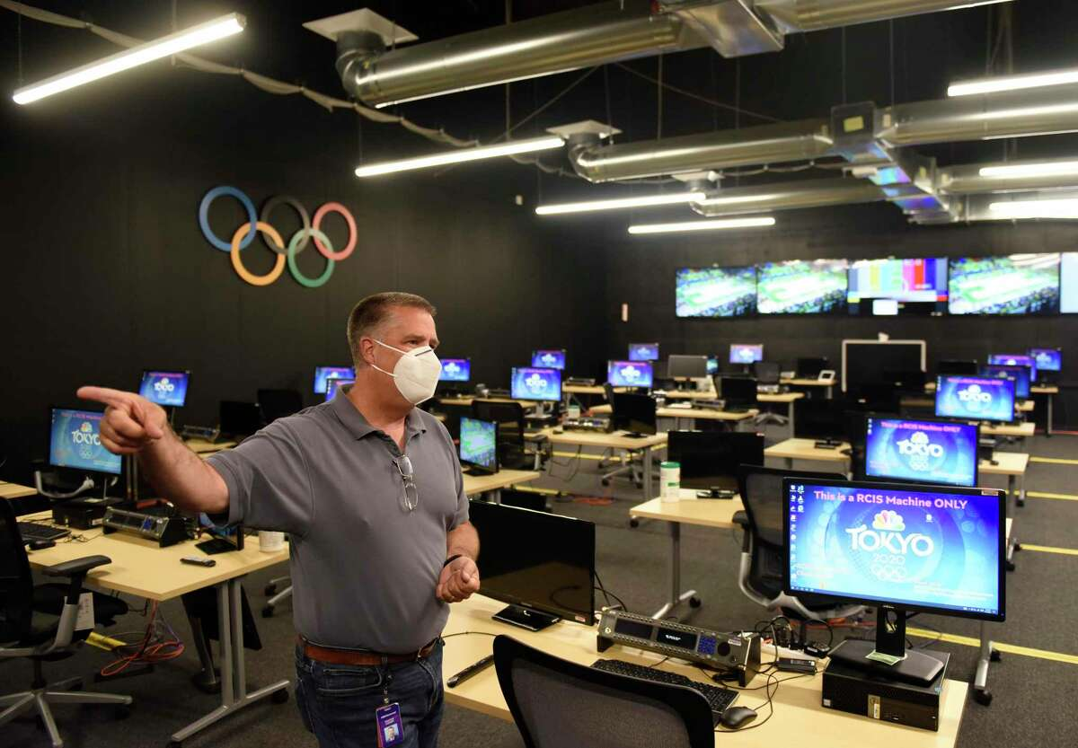 NBC Sports Vice President of Engineering Tim Canary shows the stats room at the NBC Sports headquarters in Stamford, Conn. Tuesday, July 13, 2021. NBC Sports is preparing to cover the Tokyo 2020 Olympic Games, which were postponed a year, in a different way than usual due to the lingering pandemic.