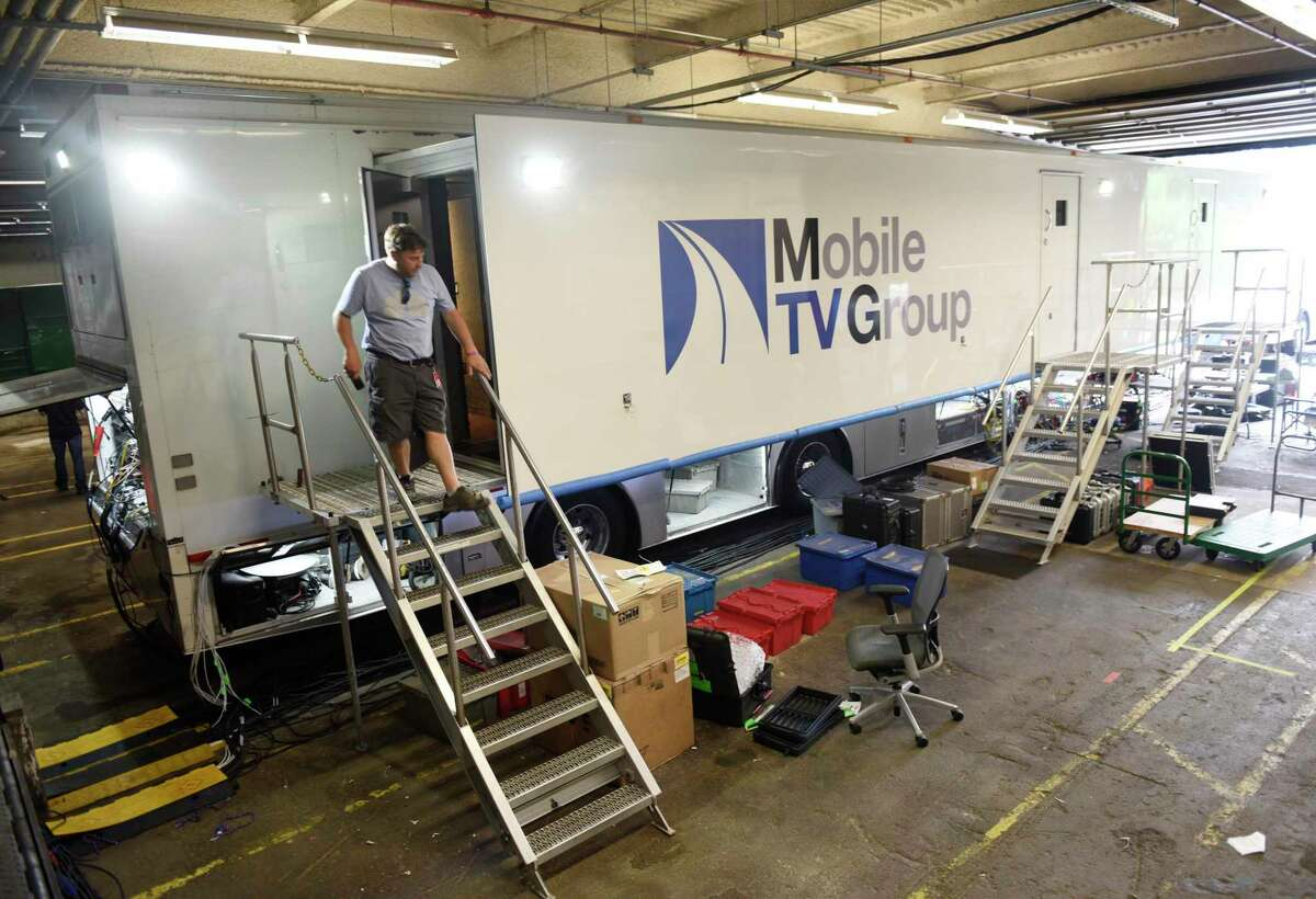 Mobile trailers are brought in to assist with Olympic coverage at NBC Sports headquarters in Stamford, Conn. Tuesday, July 13, 2021. NBC Sports is preparing to cover the Tokyo 2020 Olympic Games, which were postponed a year, in a different way than usual due to the lingering pandemic.