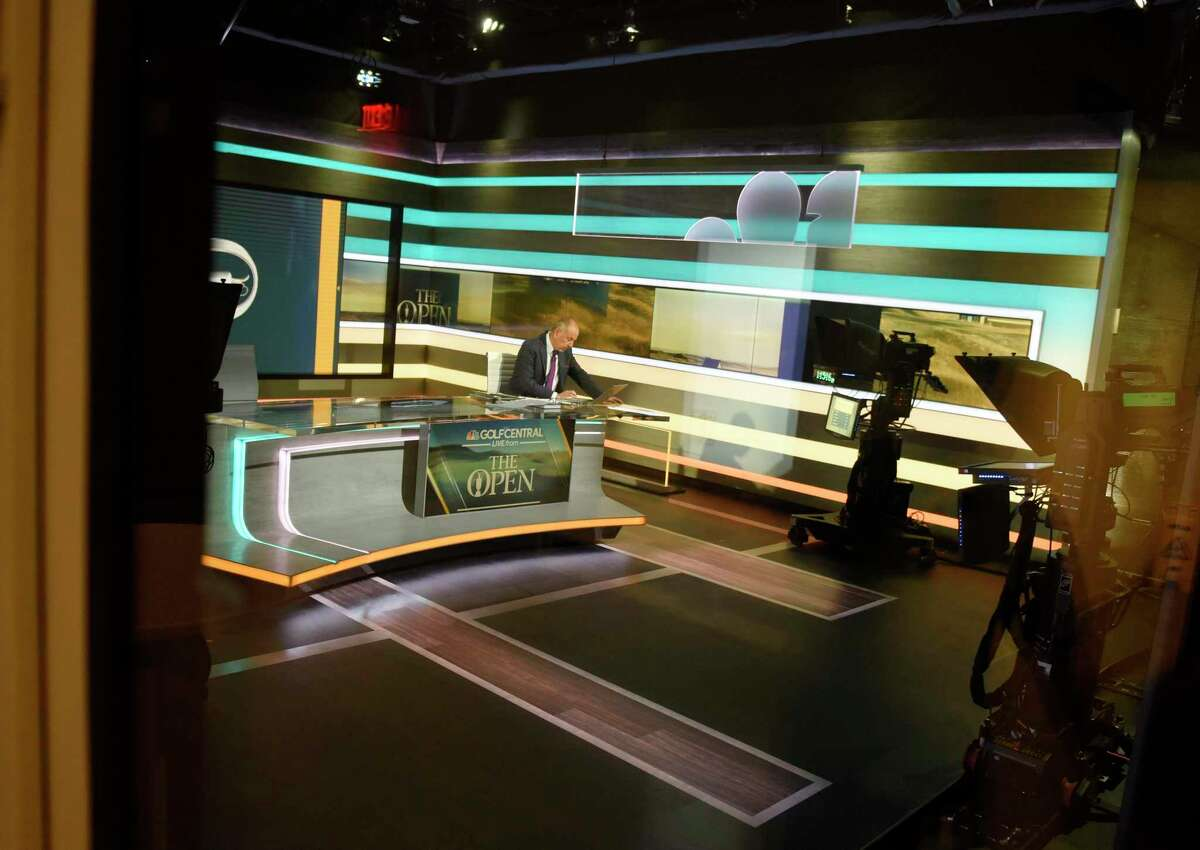 Golf analyst works in the broadcast studio at NBC Sports headquarters in Stamford, Conn. Tuesday, July 13, 2021. NBC Sports is preparing to cover the Tokyo 2020 Olympic Games, which were postponed a year, in a different way than usual due to the lingering pandemic.