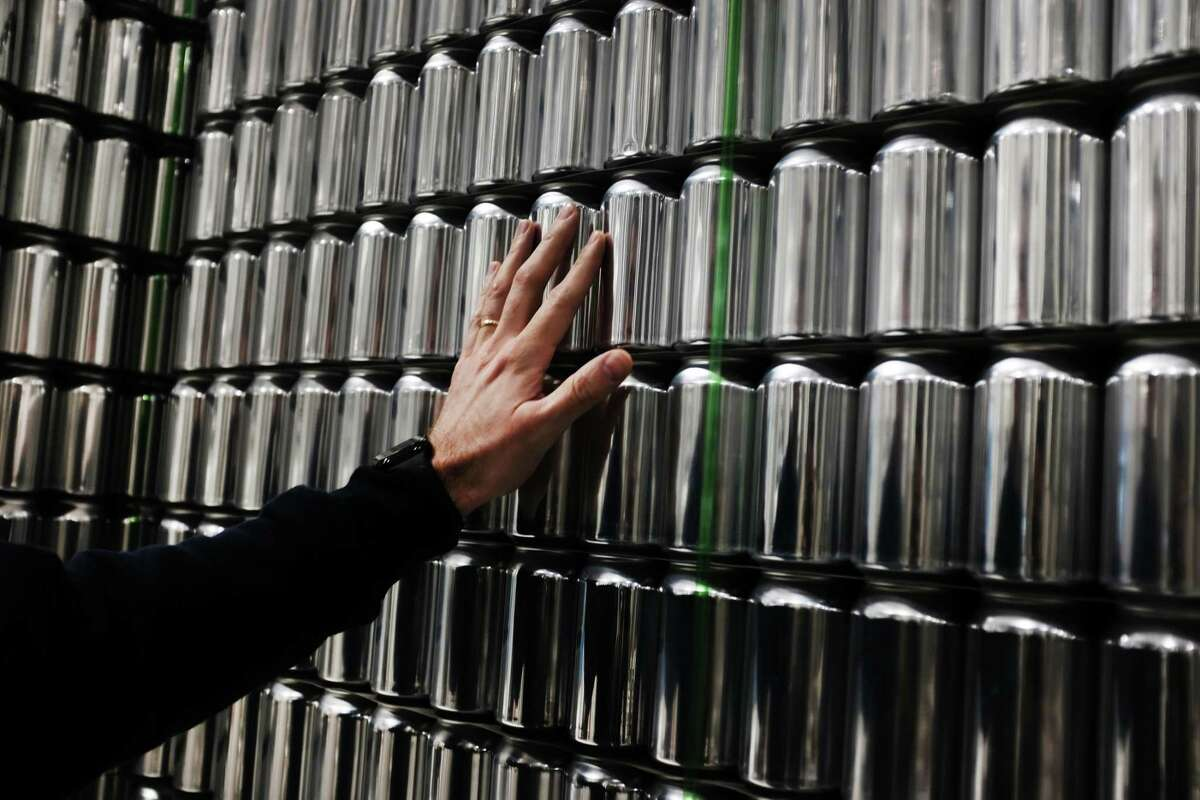 STRATFORD, CONNECTICUT - MARCH 20: Company founder Bill Shufelt inspects cans at Athletic Brewings non-alcoholic brewery and production plant on March 20, 2019 in Stratford, Connecticut.