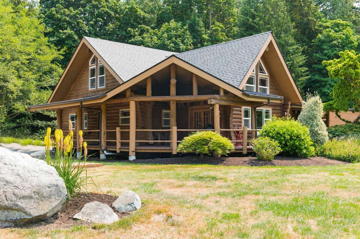 The property is nestled on an 8.2 acre lot surrounded by woods and the shoreline beyond.