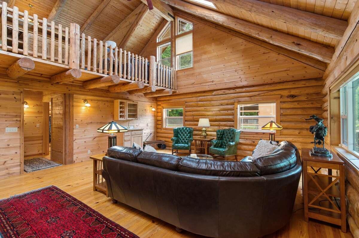 Inside, the living room offers soaring ceilings.