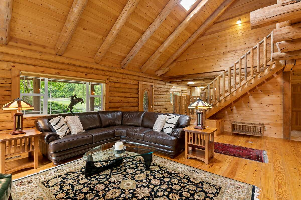 The cabin's loft-like design, all of it wood paneled, includes two levels.