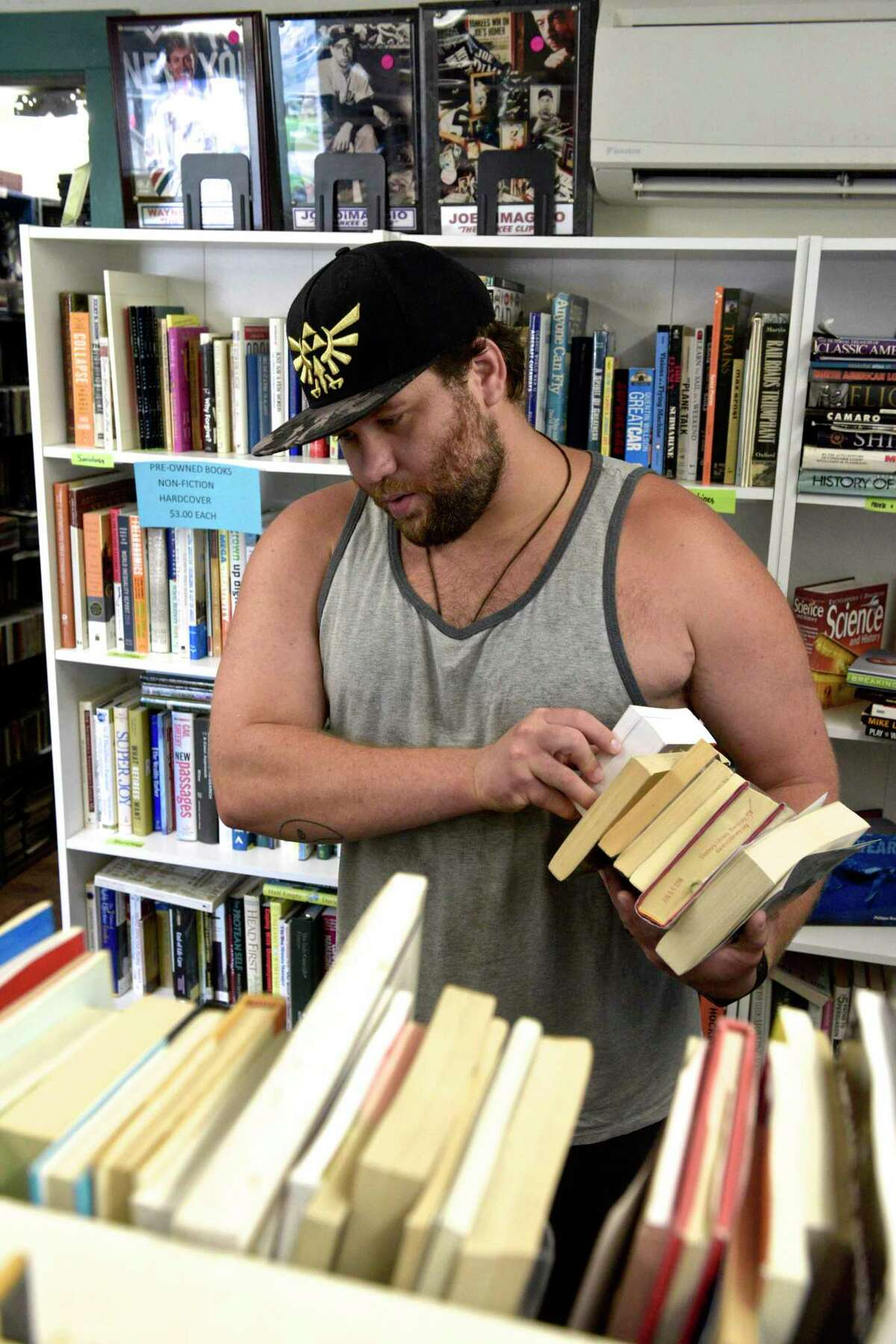 Nick Kuell, of Danbury, shops for books at the new Friends of the Danbury Library used book store at 15 Main St. in Danbury on Friday.