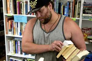 Nick Kuell, of Danbury, shops for books at the new Friends of the Danbury Library used book store at 25 Main Street. Friday, July 16, 2021, in Danbury, Conn.