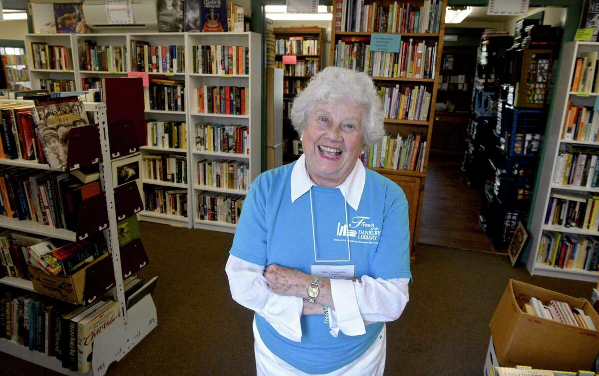 Mary Cappiello co-chair of the Friends of the Danbury Library used book store at 15 Main St. in Danbury on Friday. Below,