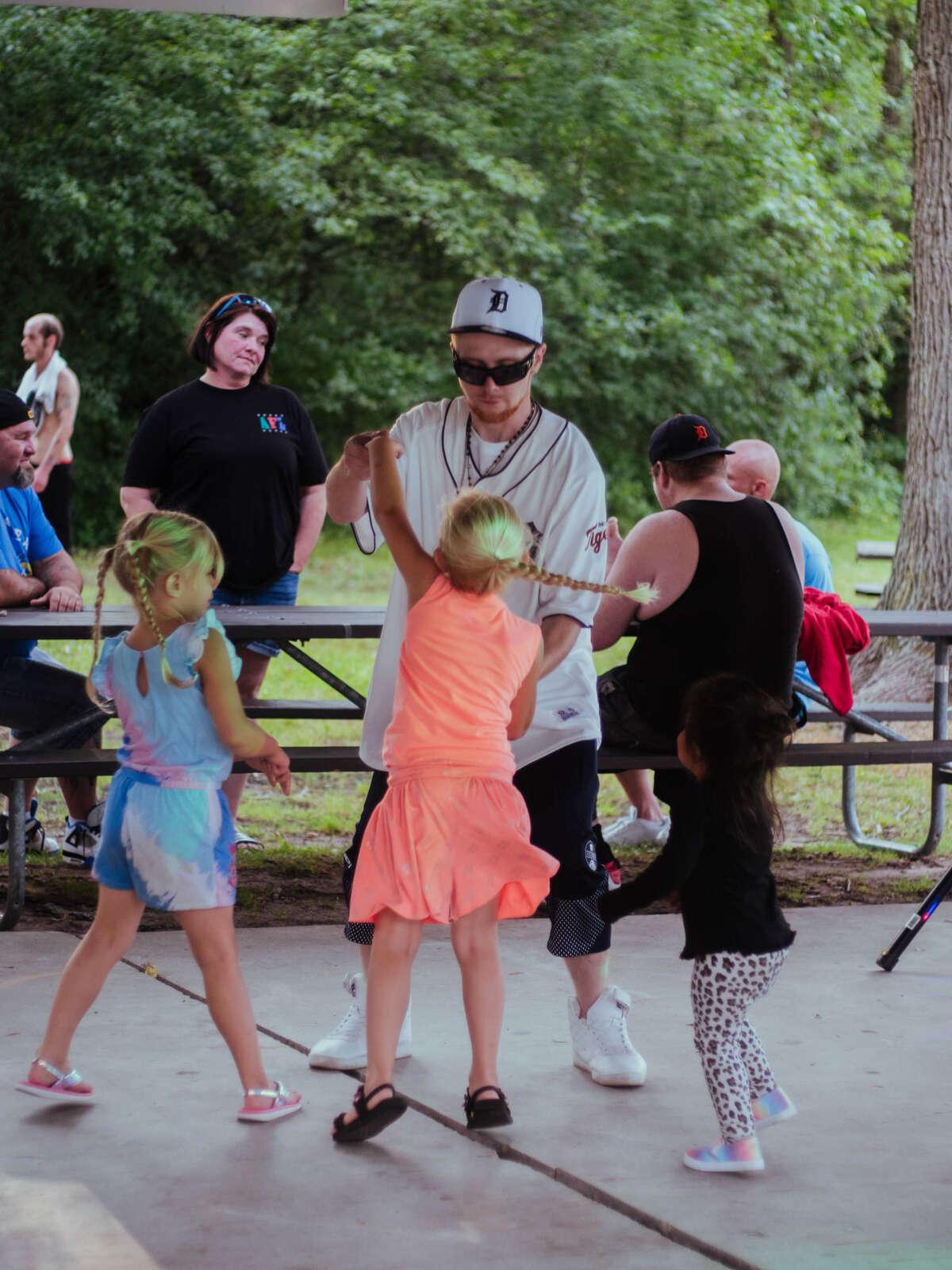 Austin Banks dances with visitors at a past Party at the Pavilion.