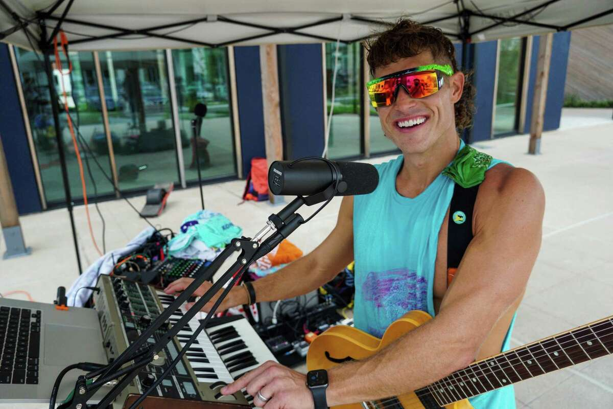 Derek Cooper, AKA Legacy Man, a Heights resident who makes his own synthwave music and roller blades, performing at Height's MKT Sunset Markets in Houston on July 15, 2021.