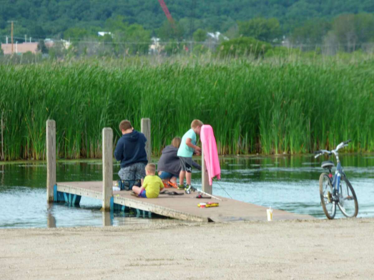 A group of young anglers try their luck fishing off a dock at Penny Park. (News Advocate file photo)