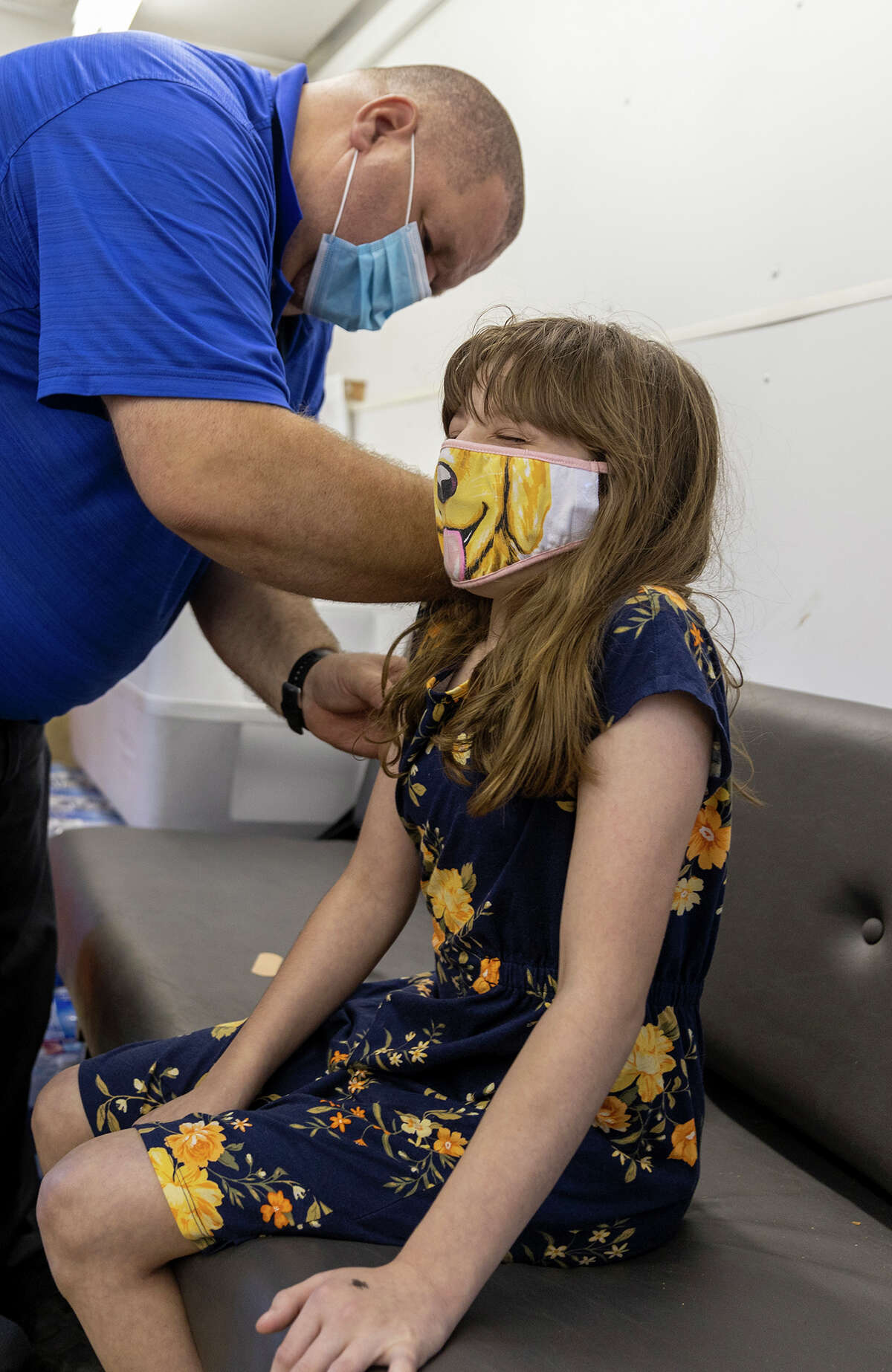 Kerri Denton, 13, gets a vaccine shot from Essex County nurse Jim Thomsen on Monday, June 7, 2021. If more children are vaccinated, it will keep more students in-person in school this year, officials say. Photo by Mike Lynch