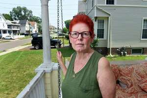 Victoria Clifford, photographed on her porch on Richards Place in West Haven on July 16, 2021, lives down the street from The Haven mall project.
