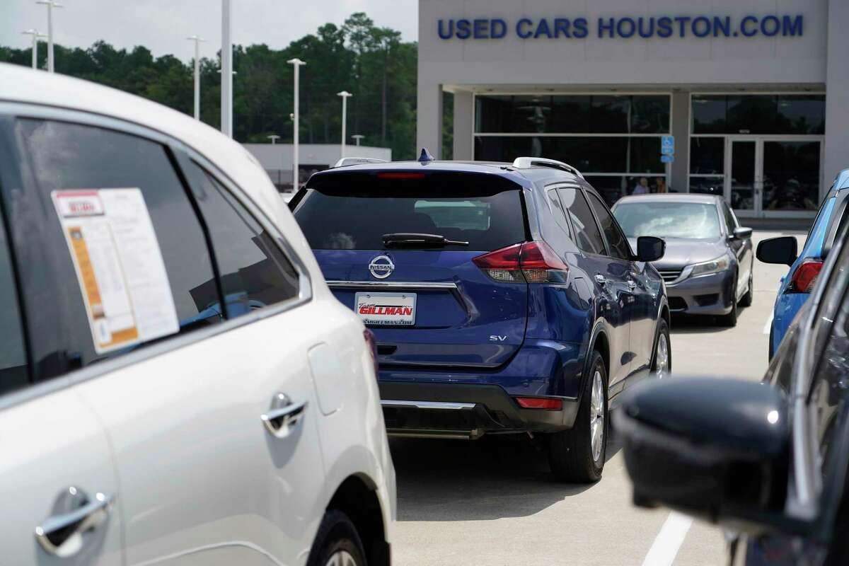 A selection of used vehicles at Team Gillman Subaru North 18202 North Fwy., are shown Friday, July 16, 2021 in Houston. Inventory of new vehicles is low.