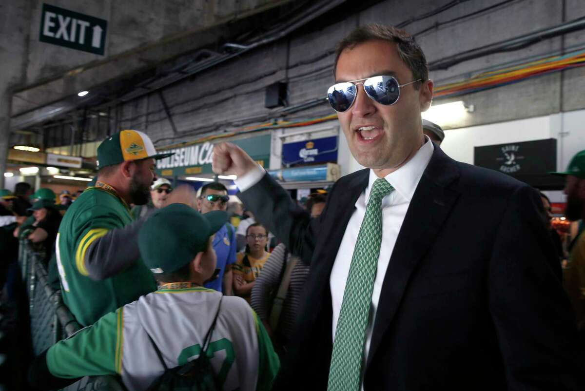 Team president Dave Kaval walks through the stands to greet fans before the Oakland A's home opener in 2019.