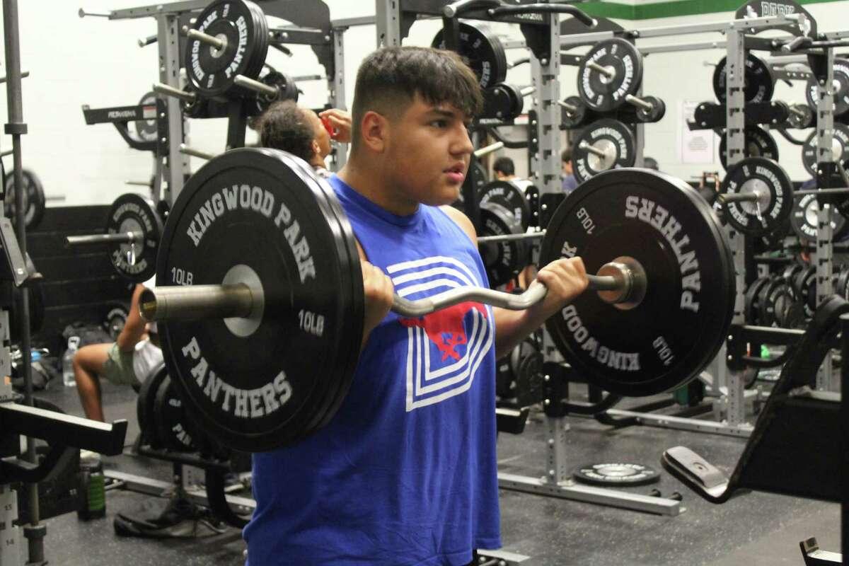 Kingwood Park offensive lineman Erik Contreras lifting weights during summer workouts.