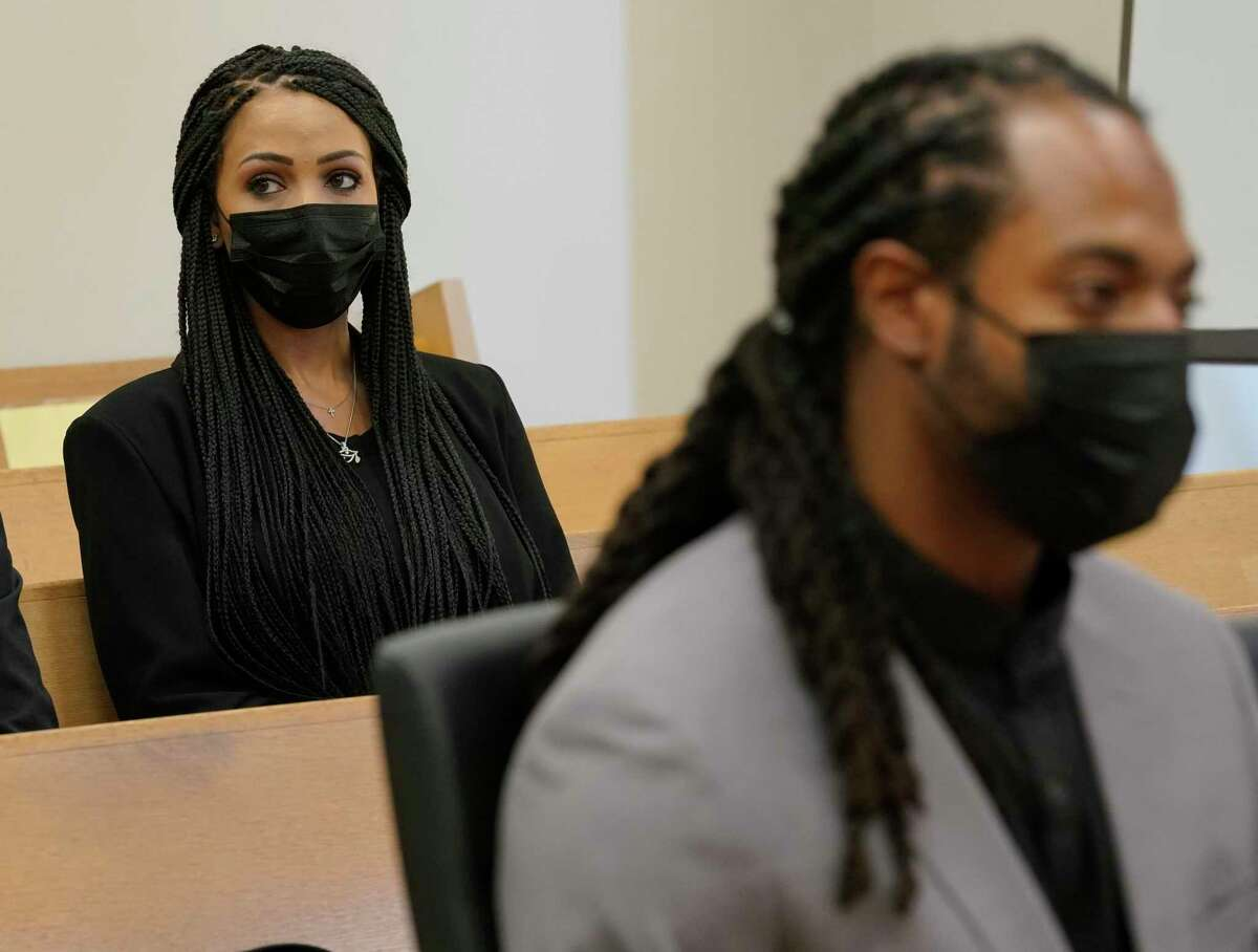 Richard Sherman, right, sits in a King County District Court hearing as his wife Ashley, left, looks on, Friday, July 16, 2021, in Seattle. The NFL football cornerback, who has played with the Seattle Seahawks and the San Francisco 49ers, was arraigned on five criminal charges Friday after he was arrested Wednesday after police said he crashed his car in a construction zone along a busy highway east of Seattle and then tried to break into his in-laws' home in the suburb of Redmond, Wash. (AP Photo/Ted S. Warren)