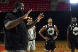 Kendrick Perkins, a former NBA players and Southeast Texas native, addresses players during the first day of tryouts for the Beaumont Panthers, a professional basketball team spearheaded by Perkins. It was an idea born out of a conversation with new Beaumont City Councilman A.J. Turner, who spoke to the need for young people especially to have a point of pride in their community. Tryouts continued Sunday at the Montagne Center, with a second two-day round of tryouts scheduled in November. The team's game season is set to begin next spring. Photo made Saturday, July 3, 2021 Kim Brent/The Enterprise
