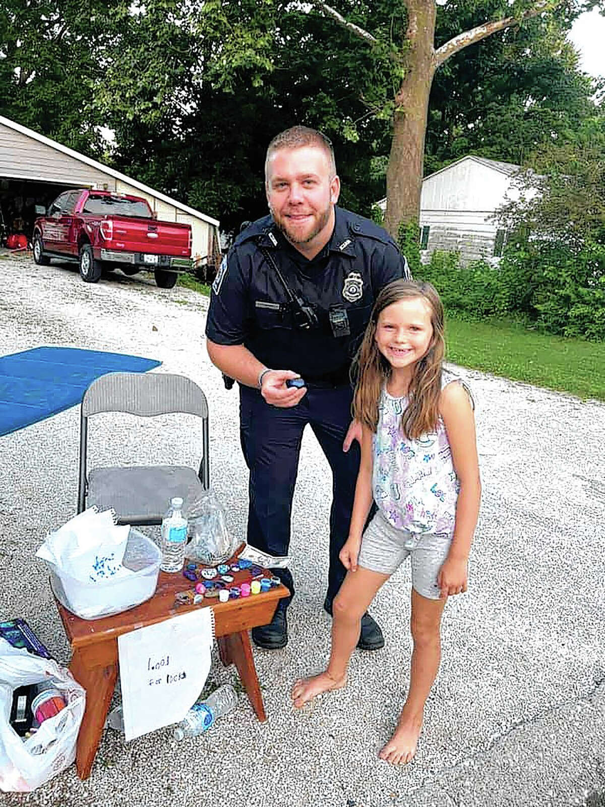 While on patrol Tuesday evening, South Jacksonville patrolmen Hunter Parks and Daniel Bormann (not shown) noticed Alaina Shillings selling painted rocks at 1712 Linden St. As part of their efforts to build positive relationships with the community, Parks and Bormann made a non-routine stop to buy custom-painted rocks from Alaina.
