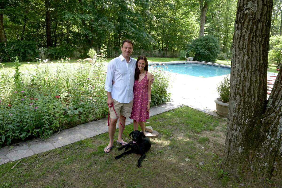 Laurie Thompson, right, and Robert Commisso have moved their family to Redding during the pandemic. Friday, July 16, 2021, in Redding, Conn. Including their dog Trey.
