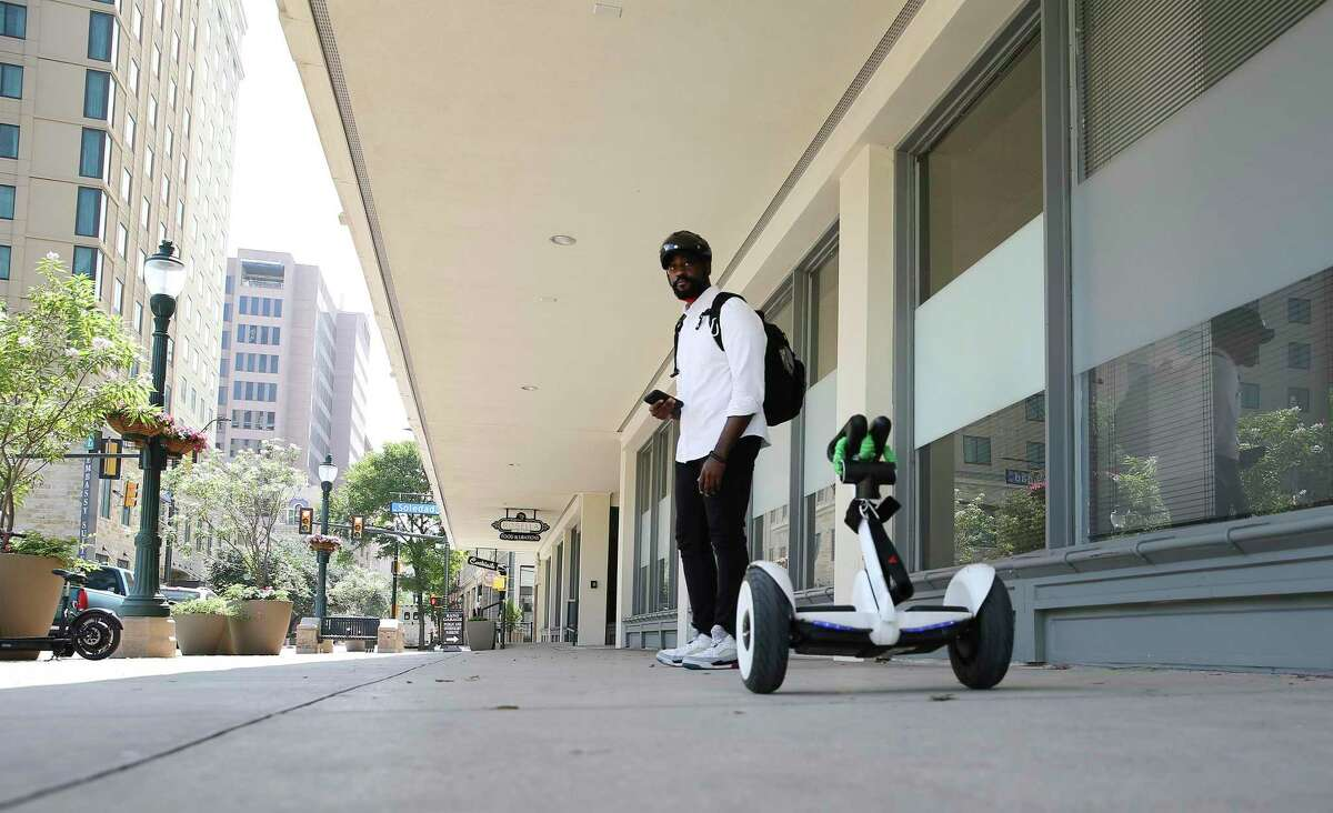 Hoverville founder Terry French uses a self-balancing electric transporter as transportation from his office at Geekdom along Houston Street on Wednesday, July 14, 2021. Some people in the local technology industry are leading a grass roots effort to close Houston Street to motor vehicles. The proposal to shut off motor vehicle traffic along Houston street in the downtown area has recently been brought up on social media.