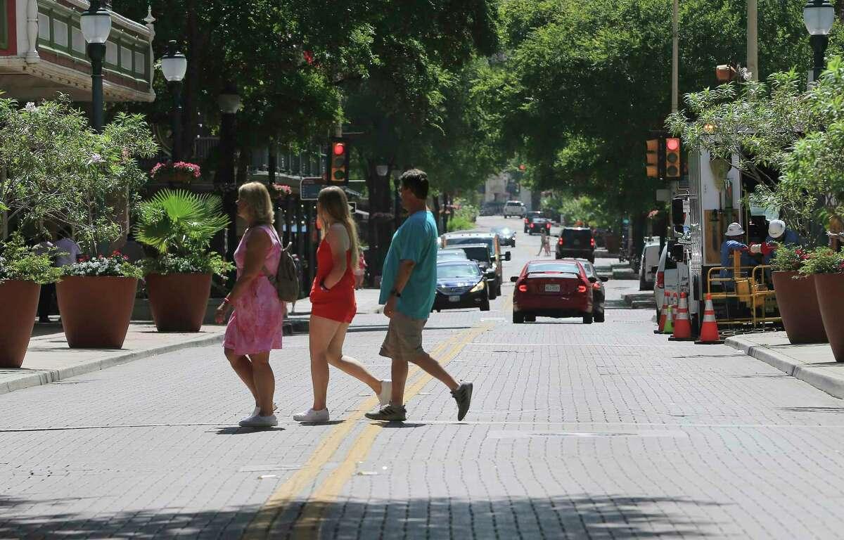San Antonio pedestrians cross Houston Street earlier this summer.