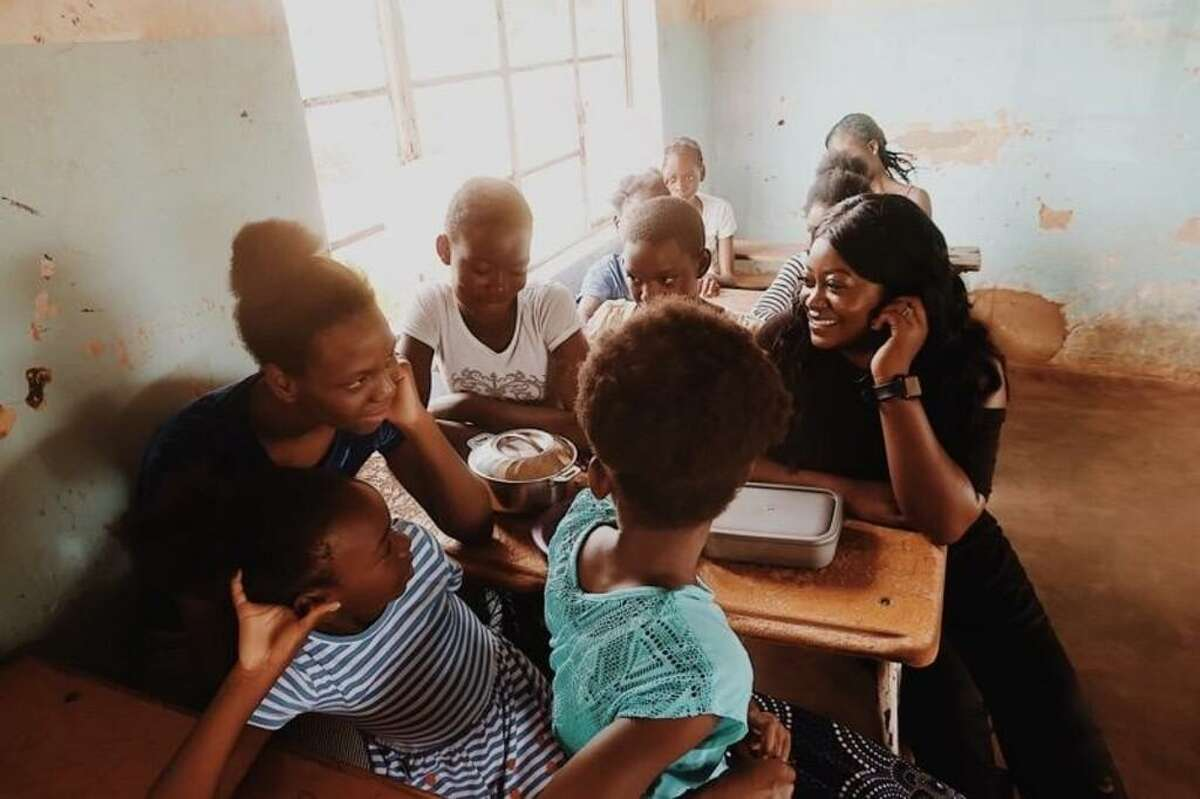 Rose Mutale engages girls at a school in Zambia about their educational goals. Mutale, founder of a non-profit that helps girls in poverty-ridden, rural areas of Zambia, recently graduated from Southern Connecticut State Unversity