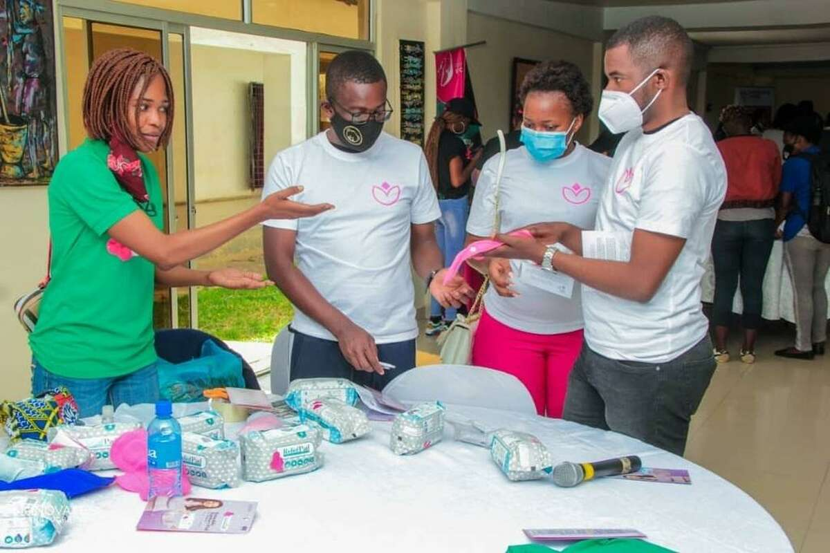 """The """"For Her Pride"""" team in Lusaka attends the """"Period Festival"""" in May of 2021, handing out menstrual hygiene products and information to the girls."""
