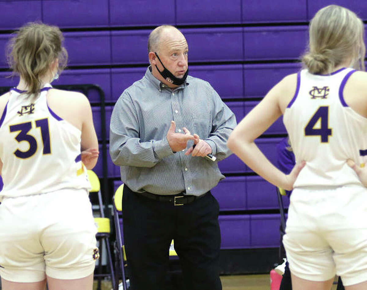 CM coach Mike Arbuthnot (middle) talks with his team during a mask break in a game last season in Bethalto. Arbuthnot, in his first season at Civic Memorial, is the 2021 Telegraph Large-Schools Girls Basketball Coach of the Year.
