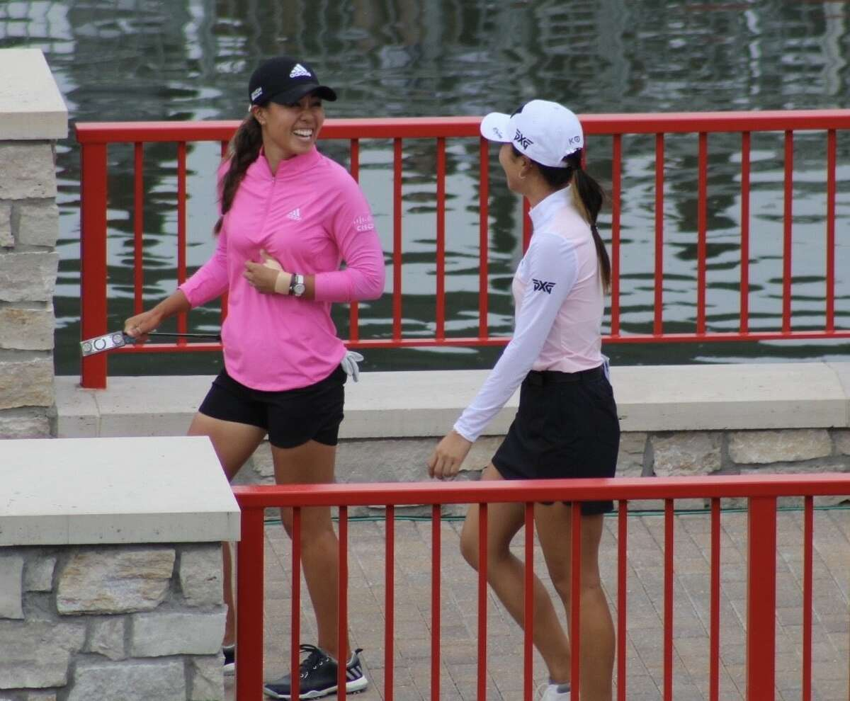Danielle Kang (left) and Lydia Ko (right) enjoy their walkup song on the 18th hole at the Dow GLBI on July 16 at the Midland Country Club. (Austin Chastain/austin.chastain@hearstnp.com)