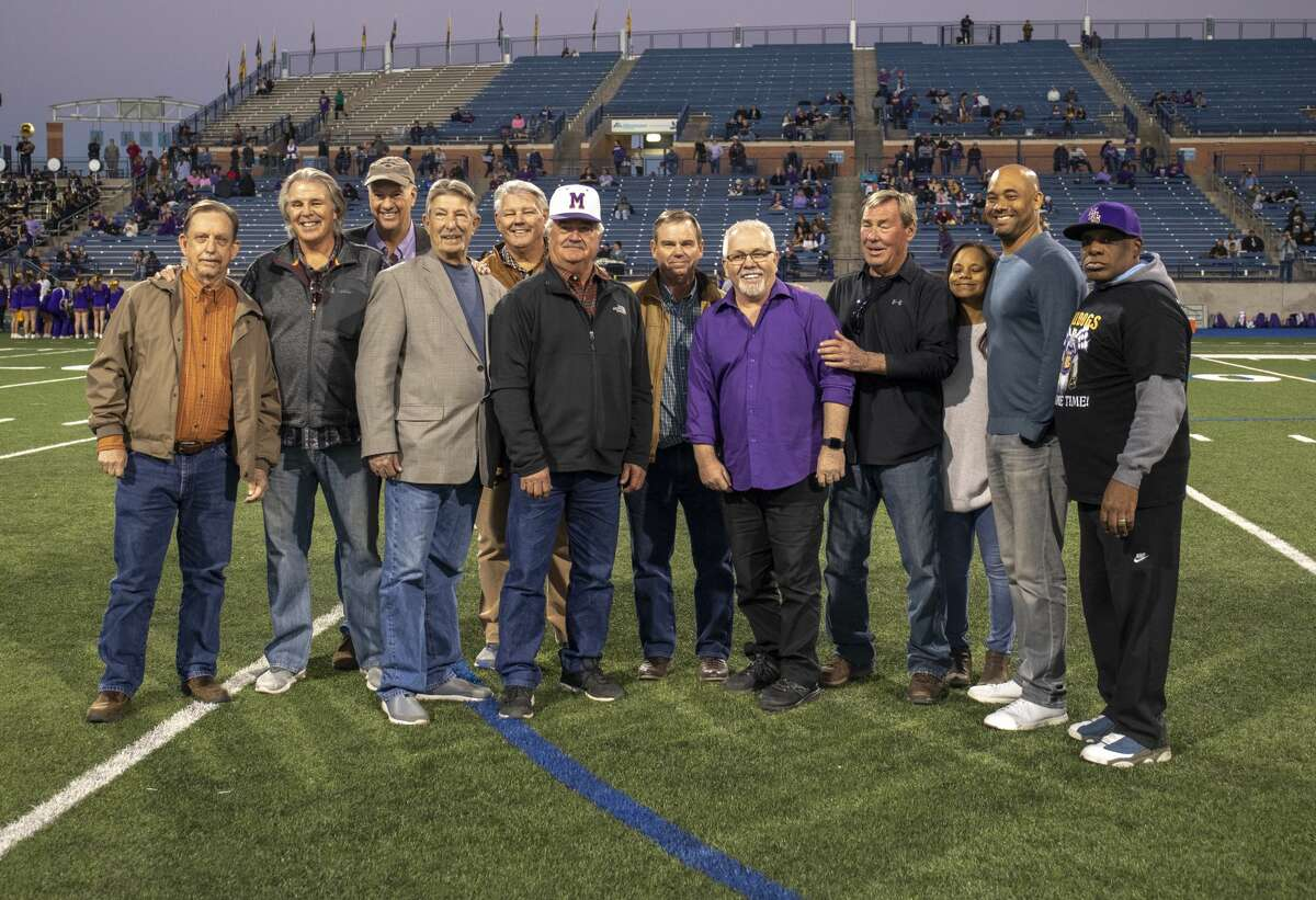 Midland High's 1973 baseball team poses together Friday, Nov. 1, 2019 at Grande Communications Stadium before the team was inducted into the Midland ISD Hall of Legends. Randall Blanscett, pictured fourth from the right, passed away this week at the age of 66.
