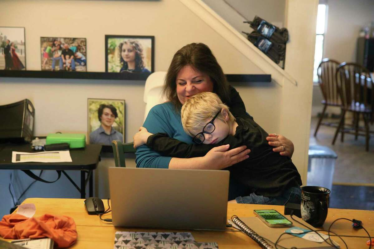 Simon Ryan gets a hug from his mother, Sheila, before the start of home-based learning from Great Hearts Online. Gov. Greg Abbott must see House Bill 1468, which supports online education, to the finish line.