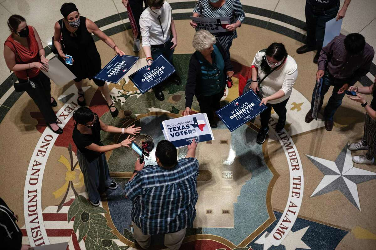 People opposed to the Texas Republican-led effort to pass new voting restrictions are gathered at the State Capitol as they wait to testify before state lawmakers who began committee hearings on election integrity bills on July 10.