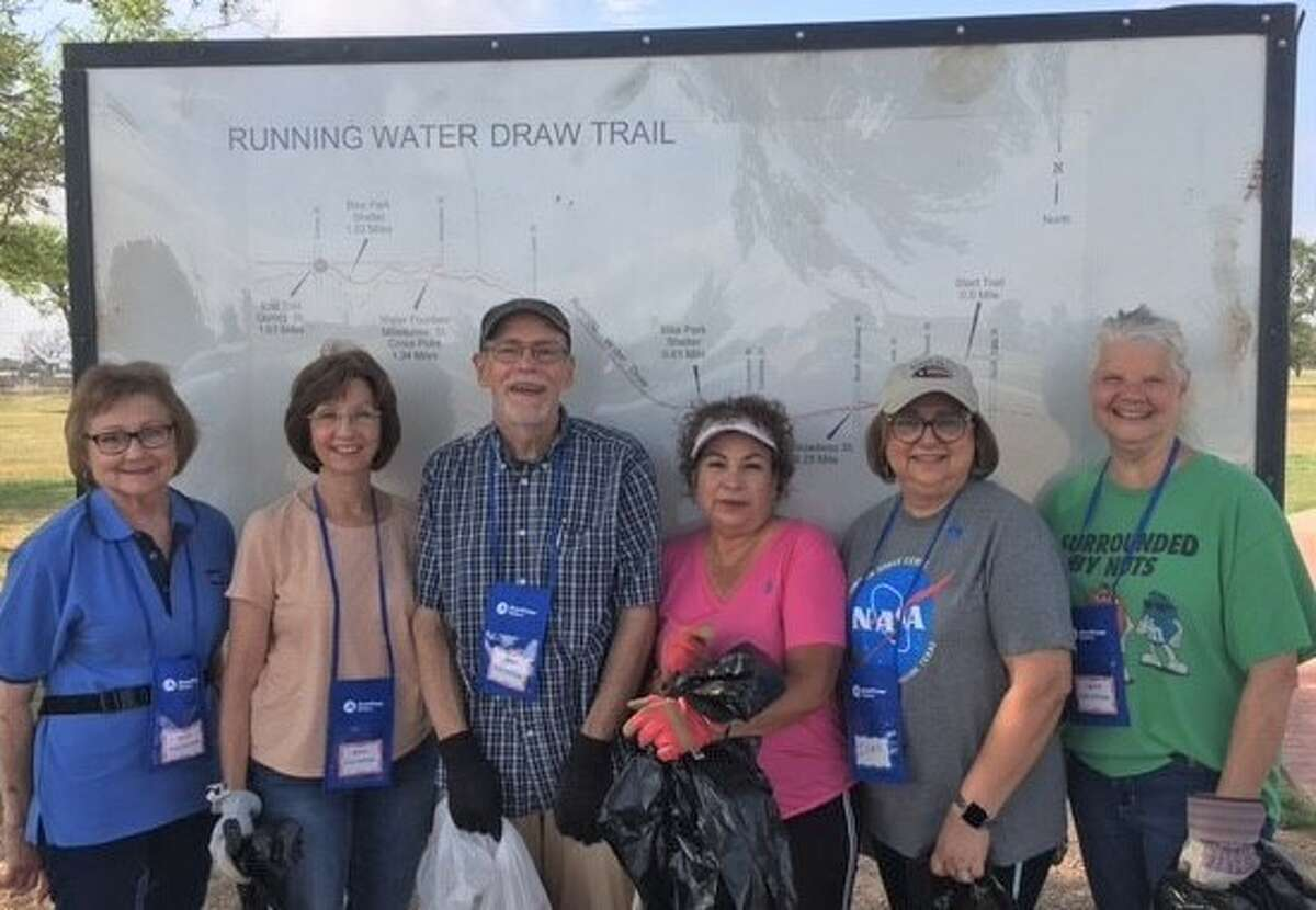 (Shown in picture are RSVP volunteers and 4-H members who assisted with this project.)