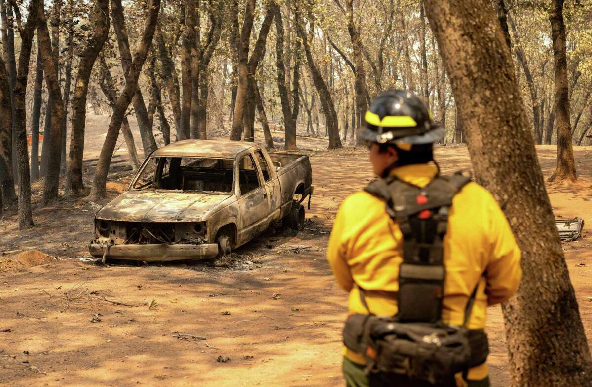 Raymond Vasquez of Wildfire Defense Systems surveys a property during the Salt Fire in the Gregory Creek area of Shasta County.