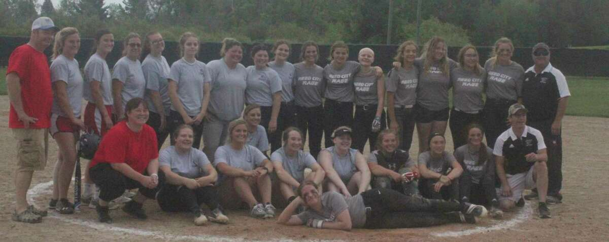Reed varsity softball and alumni players pose for pictures after Wednesday's game. (Pioneer photo/John Raffel)