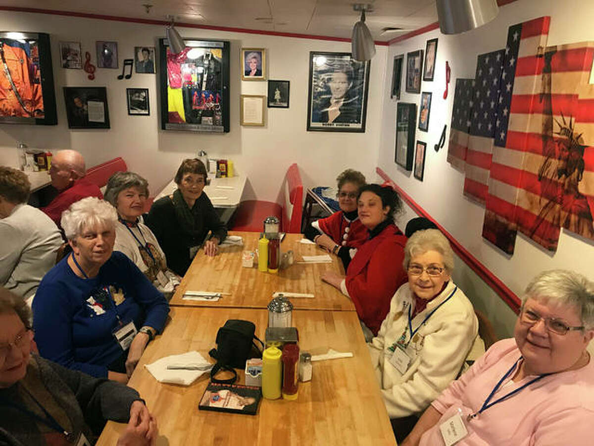 Travelers from Main Street Community Center enjoy a meal during a trip to Branson, Missouri.