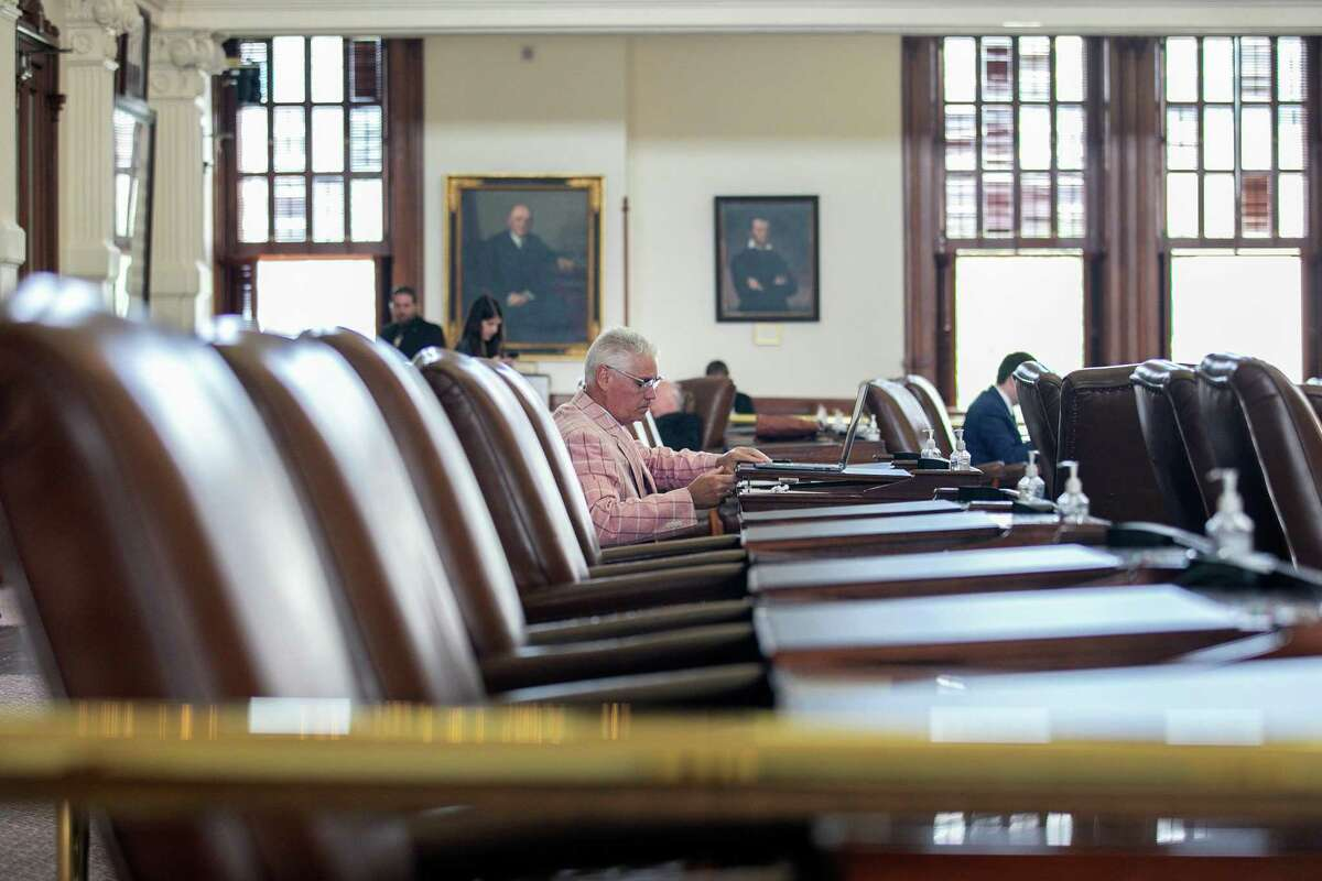 Rep. Dan Huberty, R-Kingwood, sits among empty chairs in the Texas House Chamber on July 13. The Texas House voted to arrest Democrats who fled the state to deny a quorum in protest of Republicans' controversial voting bill.