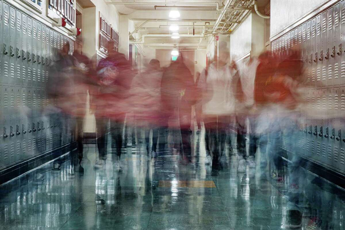 """FILE -- Students walk through a hallway at a high school in Pasadena, Calif., Dec. 6, 2019. """"The debate about critical race theory has become circular and maddening because the phrase itself has been unmoored from any fixed meaning,"""" writes New York Times columnist Michelle Goldberg. (Damon Winter/The New York Times)"""